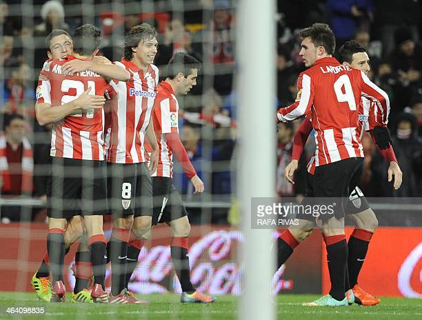 Athletic Bilbao's midfielder Oscar de Marcos celebrates a goal with teammates during the Spanish league football match Athletic Bilbao vs Real...