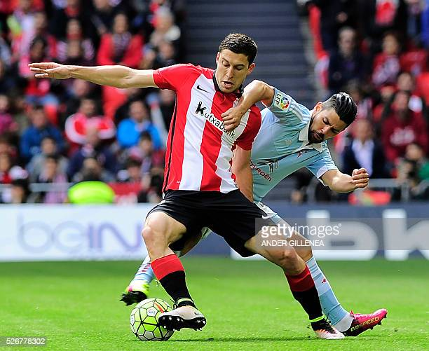 Athletic Bilbao's midfielder Oscar de Marcos vies with Celta Vigo's forward Nolito during the Spanish league football match Athletic Club de Bilbao...