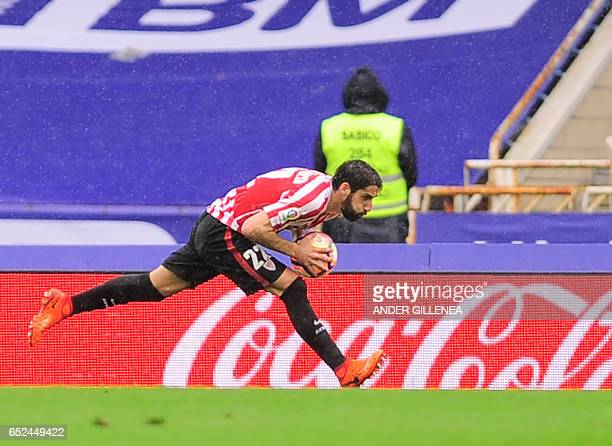 Athletic Bilbao's midfielder Raul Garcia celebrates after scoring his team's first goal during the Spanish league football match Real Sociedad vs...