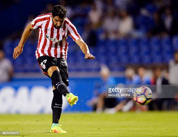 Athletic Bilbao's midfielder Raul Garcia shoots to score a goal during the Spanish league football match RC Deportivo vs Athletic Club de Bilbao at...