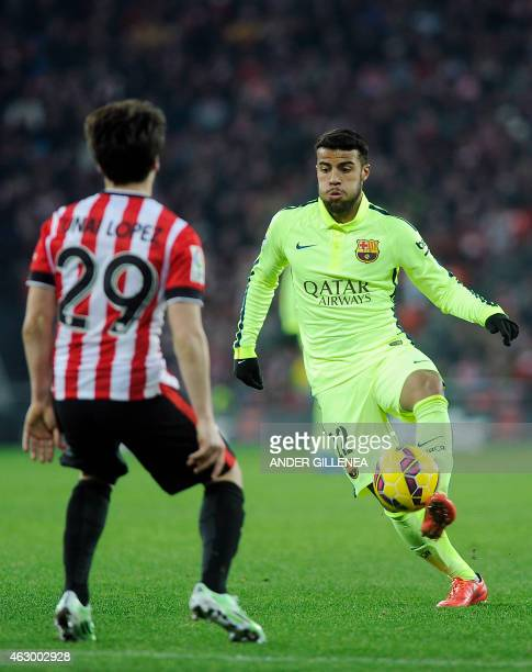 Athletic Bilbao's midfielder Unai Lopez vies with Barcelona's midfielder Rafinha during the Spanish league football match Athletic Club Bilbao vs FC...