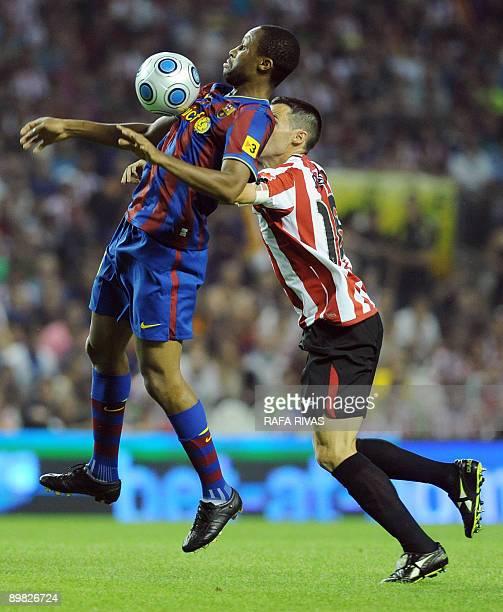 Athletic Bilbao's Pablo Orbaiz vies with Barcelona's Seydou Keita of Mali during their Spanish Supercup 1st leg football match on August 16 at San...