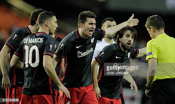 Athletic Bilbao's players argue with refeere during the UEFA Europa League round of 16 second leg football match between Valencia CF vs Athletic Club...