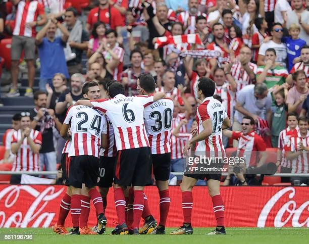 Athletic Bilbao's players celebrate a goal during the Spanish league football match Athletic Club Bilbao vs Sevilla FC at the San Mames stadium in...