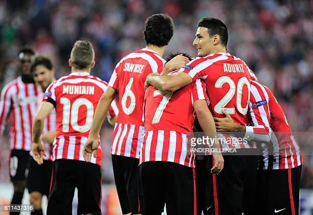 Athletic Bilbao's players celebrate after midfielder Benat Etxebarria scored his team's first goal during the Europa League Group F football match...