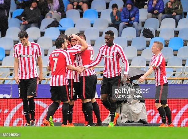 Athletic Bilbao's players celebrate after scoring their team's first goal during the Spanish league football match Real Sociedad vs Athletic Club...