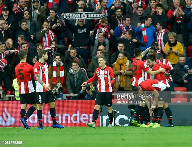 Athletic Bilbao's players celebrate after Spanish forward Inaki Williams scored a goal during the Spanish League football match between Athletic Club...