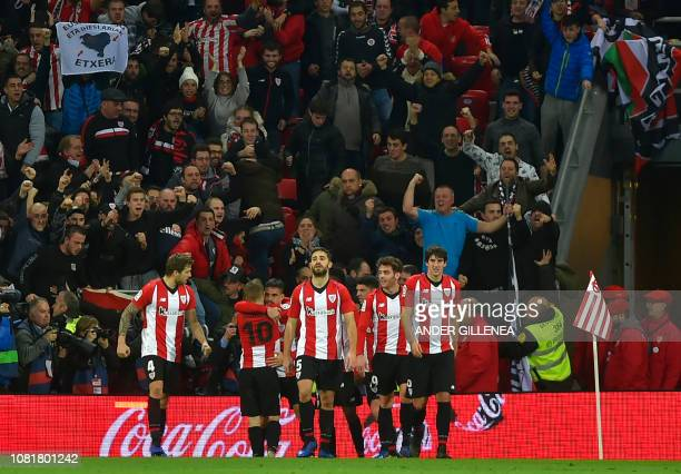 Athletic Bilbao's players celebrate after Spanish forward Inaki Williams scored his second goal during the Spanish League football match between...
