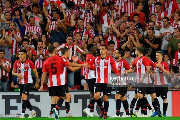 Athletic Bilbao's players celebrate after teammate Spanish forward Iker Muniain scored a goal during the Spanish league football match between...