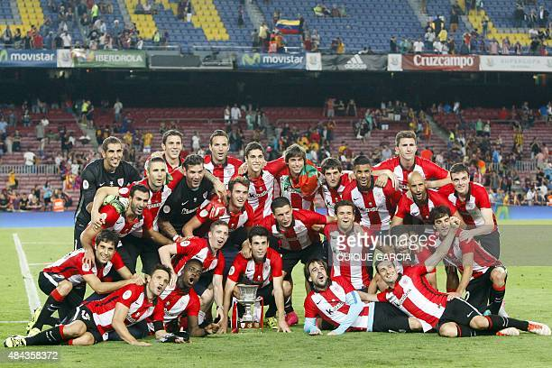 Athletic Bilbao's players celebrate after the Spanish Supercup match FC Barcelona vs Athletic club Bilbao at the Camp Nou stadium in Barcelona on...
