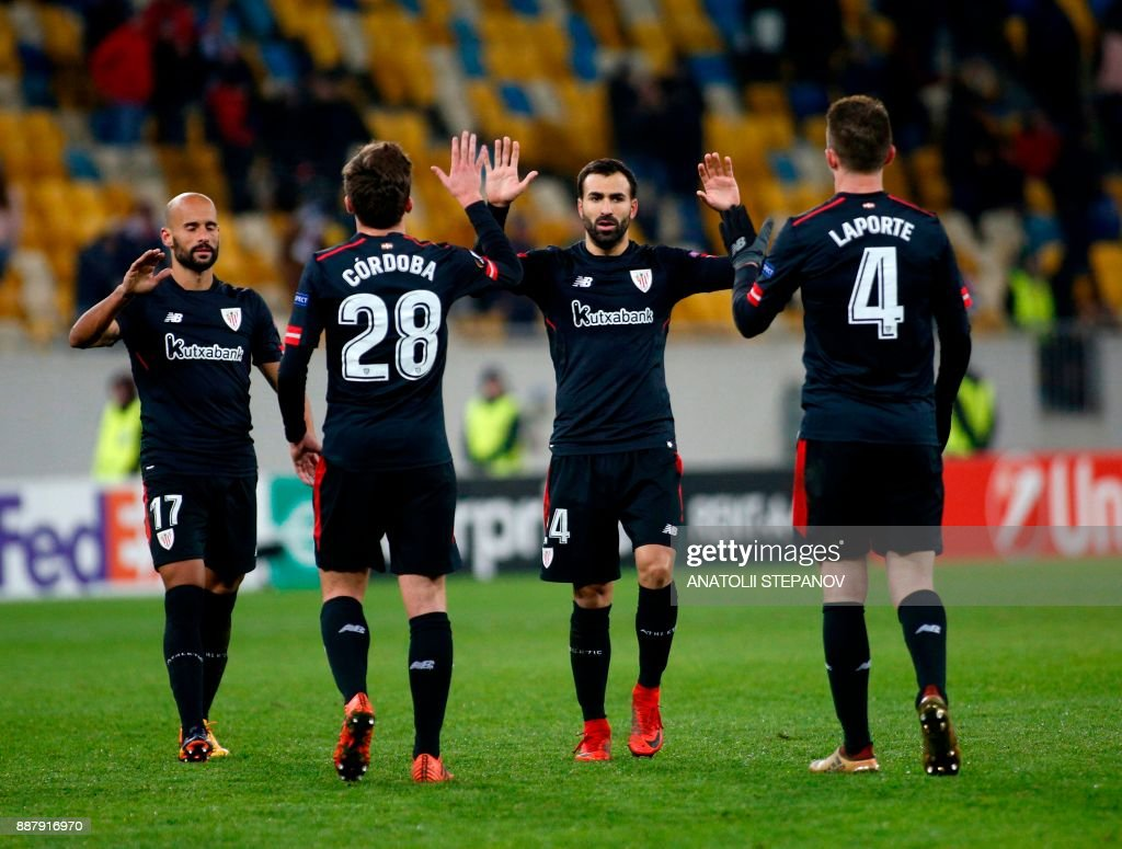 Athletic Bilbao's players celebrate after victory in the UEFA Europa League Group J football match between Zorya Luhansk and Athletic Bilbao in Lviv on December 7, 2017. /