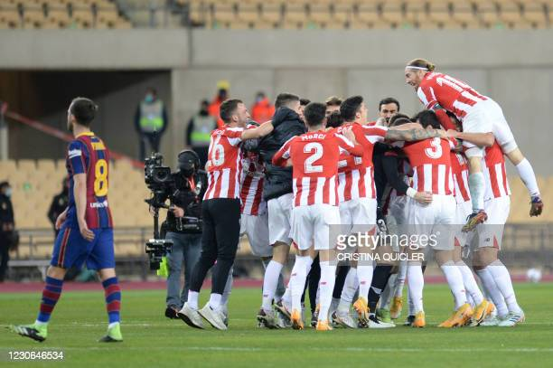 Athletic Bilbao's players celebrate after winning the Spanish Super Cup final football match between FC Barcelona and Athletic Club Bilbao at La...