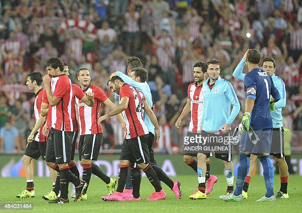 Athletic Bilbao's players celebrate after winning the Spanish Supercup firstleg football match Athletic Club Bilbao vs FC Barcelona at the San Mames...