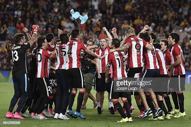 Athletic Bilbao's players celebrate after winning the the Spanish Supercup match during the Spanish Supercup secondleg football match FC Barcelona vs...
