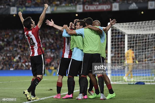 Athletic Bilbao's players celebrate Athletic Bilbao's forward Aritz Aduriz's goal during the Spanish Supercup secondleg football match FC Barcelona...