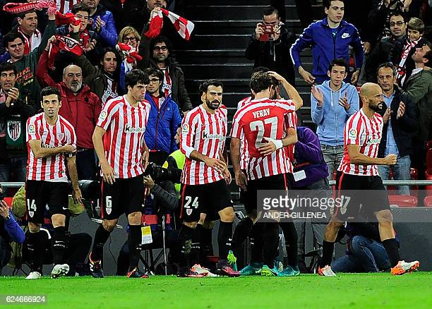 Athletic Bilbao's players celebrate their team's first goal during the Spanish league football match Athletic Club Bilbao vs Villarreal CF at the San...