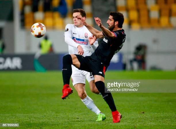 Athletic Bilbao's Raul Garcia fights for the ball with Zorya's Oleksandr Andriyevskiy during the UEFA Europa League Group J football match between...
