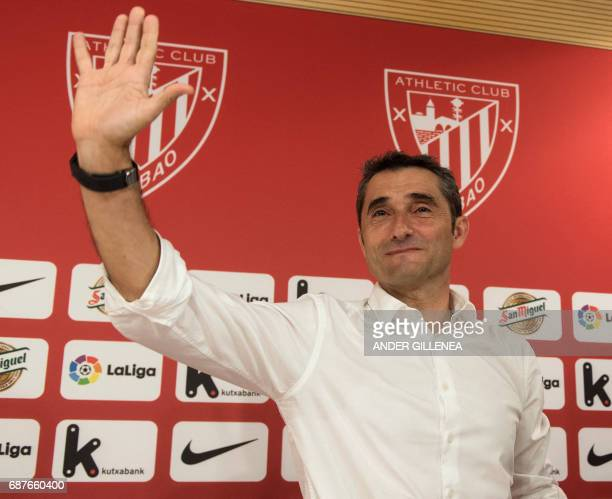 Athletic Bilbao's Spanish coach Ernesto Valverde waves journalist at the end of a press conference held to announce that he was quitting the football...
