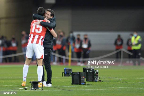 Athletic Bilbao's Spanish coach Marcelino celebrates with Athletic Bilbao's Spanish defender Inigo Lekue after winning the Spanish Super Cup final...