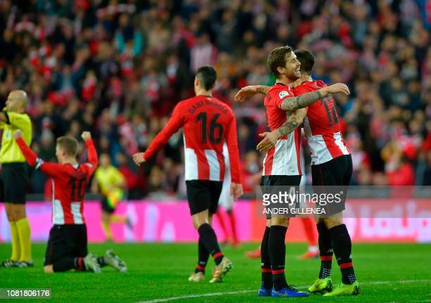 Athletic Bilbao's Spanish defender Inigo Martinez and Athletic Bilbao's Spanish defender Yuri Berchiche celebrate after the Spanish League football...
