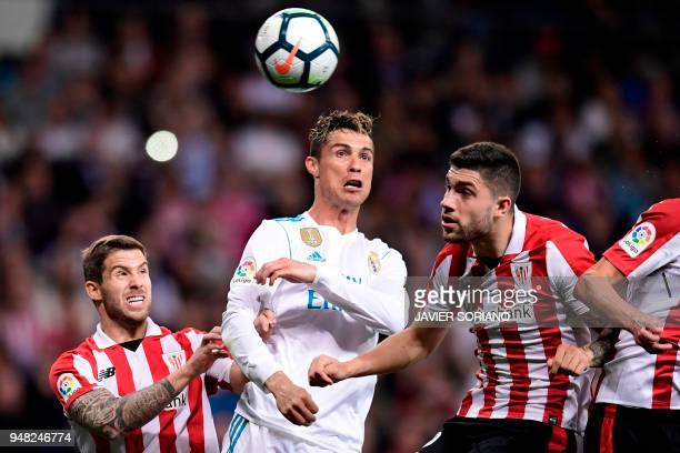 TOPSHOT Athletic Bilbao's Spanish defender Inigo Martinez and Athletic Bilbao's Spanish defender Unai Nunez vie with Real Madrid's Portuguese forward...
