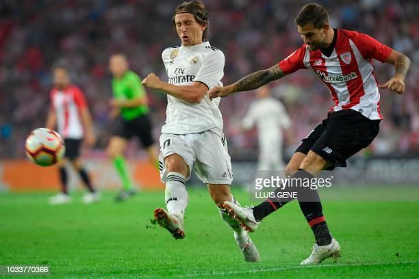 Athletic Bilbao's Spanish defender Inigo Martinez vies with Real Madrid's Croatian midfielder Luka Modric during the Spanish league football match...