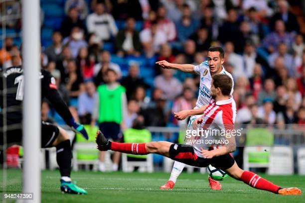 Athletic Bilbao's Spanish defender Inigo Martinez vies with Real Madrid's Spanish midfielder Lucas Vazquez in front of Athletic Bilbao's Spanish...