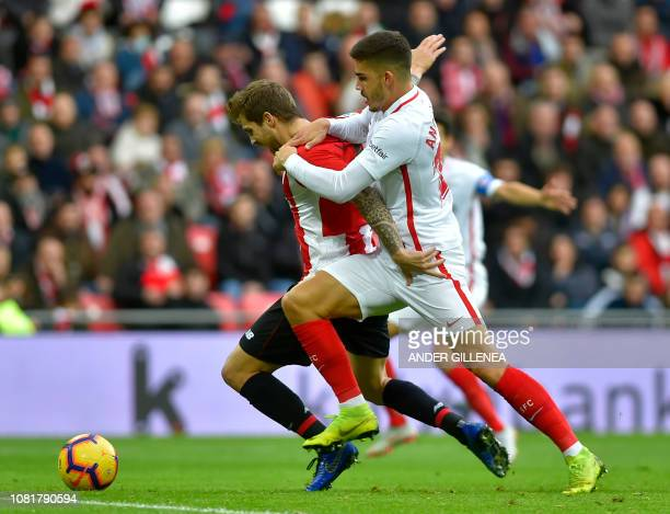 Athletic Bilbao's Spanish defender Inigo Martinez vies with Sevilla's Portuguese forward Andre Silva during the Spanish League football match between...