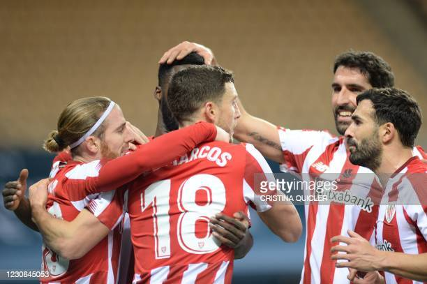 Athletic Bilbao's Spanish defender Oscar De Marcos celebrates his goal with teammates during the Spanish Super Cup final football match between FC...