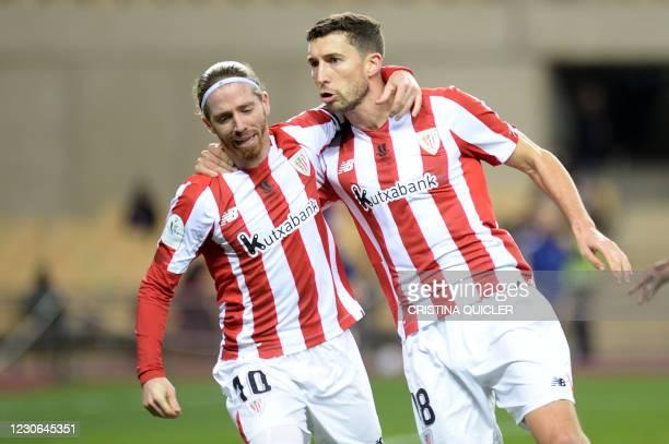 Athletic Bilbao's Spanish defender Oscar De Marcos celebrates scoring the equalizer goal with Athletic Bilbao's Spanish forward Iker Muniain during...