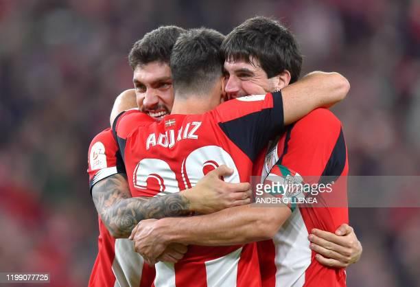 Athletic Bilbao's Spanish defender Unai Nunez Athletic Bilbao's Spanish forward Aritz Aduriz and Athletic Bilbao's Spanish defender Mikel San Jose...