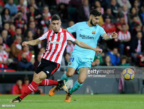 Athletic Bilbao's Spanish defender Unai Nunez vies with Barcelona's Portuguese midfielder Andre Gomes during the Spanish league football match...