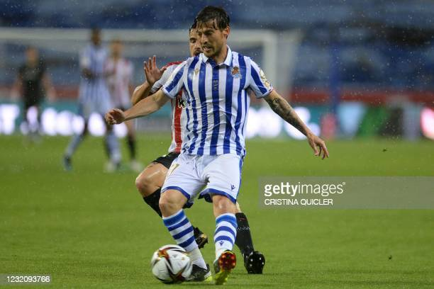 Athletic Bilbao's Spanish defender Yeray Alvarez challenges Real Sociedad's Spanish midfielder David Silva during the 2020 Spanish Copa del Rey final...