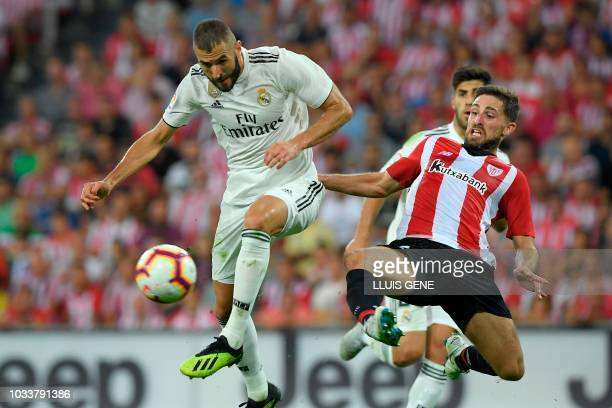 Athletic Bilbao's Spanish defender Yeray Alvarez vies with Real Madrid's French forward Karim Benzema during the Spanish league football match...