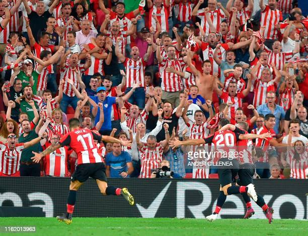 Athletic Bilbao's Spanish forward Aritz Aduriz celebrates his goal with teammates during the Spanish league football match between Athletic Club...