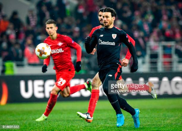 Athletic Bilbao's Spanish forward Aritz Aduriz controls the ball during the UEFA Europa League Round of 32 first leg football match between FC...