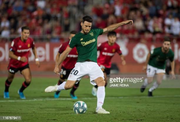 Athletic Bilbao's Spanish forward Aritz Aduriz shoots and fails a penalty during the Spanish league football match RCD Mallorca against Athletic Club...