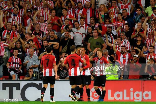 Athletic Bilbao's Spanish forward Iker Muniain celebrates with teammates after scoring a goal during the Spanish league football match between...