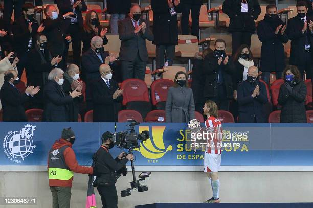 Athletic Bilbao's Spanish forward Iker Muniain receives the winner's trophy after winning the Spanish Super Cup final football match between FC...