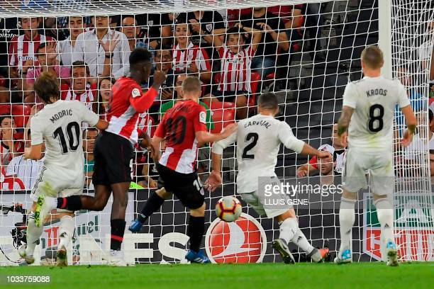 Athletic Bilbao's Spanish forward Iker Muniain scores a goal during the Spanish league football match between Athletic Club Bilbao and Real Madrid CF...