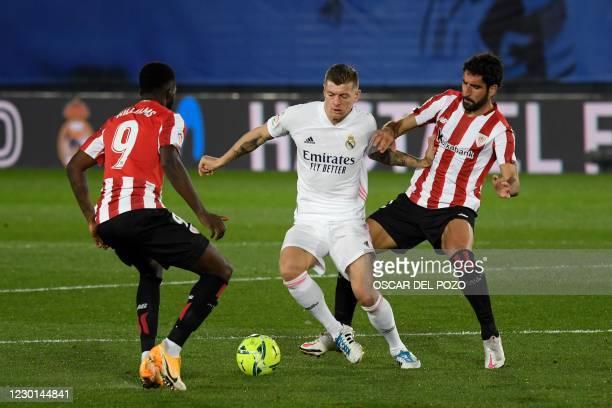 Athletic Bilbao's Spanish forward Inaki Williams and Athletic Bilbao's Spanish midfielder Raul Garcia challenge Real Madrid's German midfielder Toni...