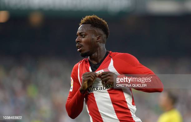 Athletic Bilbao's Spanish forward Inaki Williams celebrates the opening goal during the Spanish league football match between Real Betis and Athletic...