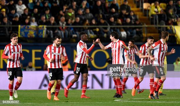 Athletic Bilbao's Spanish forward Inaki Williams celebrates with teammates after scoring during the Spanish league football match between Villarreal...
