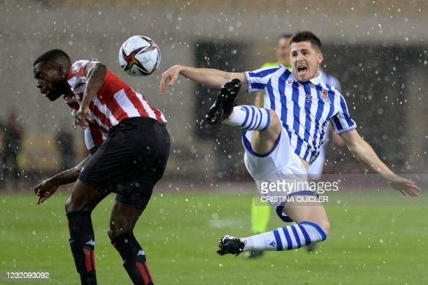 Athletic Bilbao's Spanish forward Inaki Williams challenges Real Sociedad's Spanish midfielder Igor Zubeldia during the 2020 Spanish Copa del Rey...