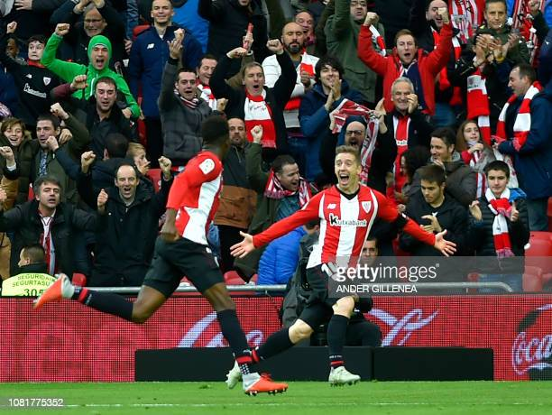 Athletic Bilbao's Spanish forward Inaki Williams is congratulated by teammate Spanish forward Iker Muniain after scoring a goal during the Spanish...
