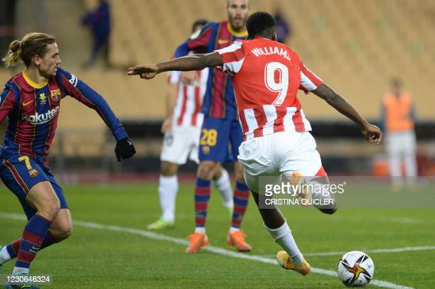 Athletic Bilbao's Spanish forward Inaki Williams shoots and scores Athletic's third goal during the Spanish Super Cup final football match between FC...