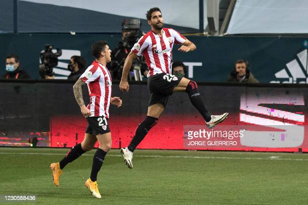 Athletic Bilbao's Spanish forward Raul Garcia celebrates after scoring during the Spanish Super Cup semi final football match between Real Madrid and...