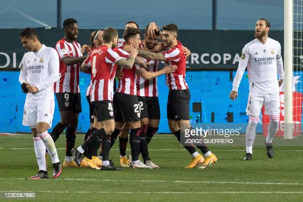 Athletic Bilbao's Spanish forward Raul Garcia celebrates with his teammates after scoring during the Spanish Super Cup semi final football match...