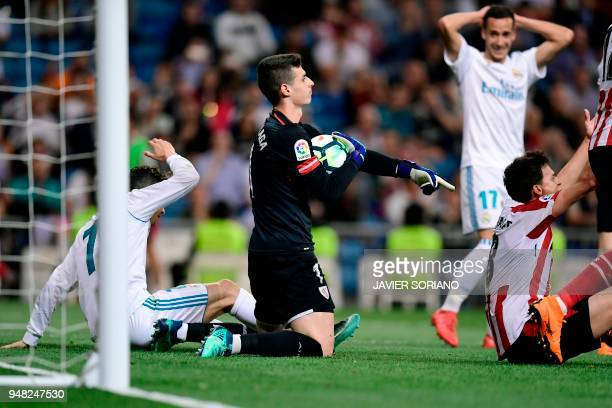 Athletic Bilbao's Spanish goalkeeper Kepa Arrizabalaga Revuelta grans the ball during the Spanish league football match Real Madrid CF against...