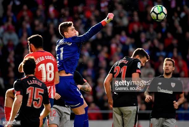Athletic Bilbao's Spanish goalkeeper Kepa Arrizabalaga Revuelta hits the ball during the Spanish league football match between Club Atletico de...